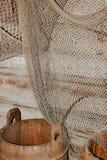 Rede para a pesca e uma cuba Imagem de Stock