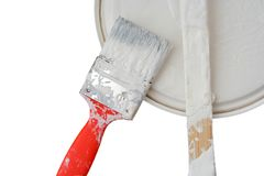 Redecorating. Paint brush, can lid and stick on white royalty free stock photo