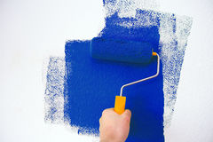 Redecoration. Paint roller with red paint Stock Photography