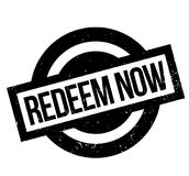 Redeem Now rubber stamp Stock Photo