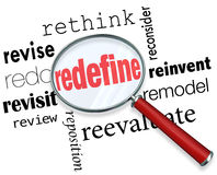 Redefine Rethink Remodel Revise Redo Magnifying Glass Words. Magnifying glass on the word Redefine and related terms such as revise, redo, revisit, review Stock Images