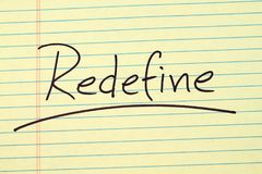 Redefine On A Yellow Legal Pad. The word `Redefine` underlined on a yellow legal pad stock image