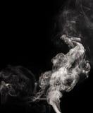 Redemoinhos brancos do fumo fotografia de stock