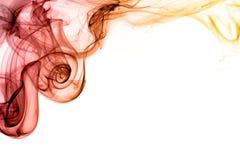 Redemoinhos vermelhos e alaranjados do fumo Imagens de Stock Royalty Free