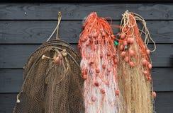 Redes de pesca em uma parede Fotos de Stock Royalty Free