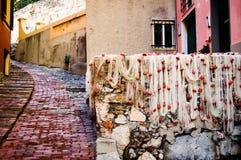 Redes de pesca que se secan en el área turística conocida como boccadasse en Génova Italia Fotografía de archivo libre de regalías