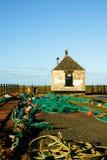 Redes de pesca que se secan en el muelle Imágenes de archivo libres de regalías