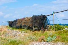 Redes de pesca que secam em polos Foto de Stock Royalty Free