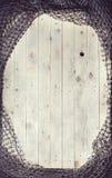 Redes de pesca sobre o fundo de madeira com espaço da cópia Fotografia de Stock Royalty Free
