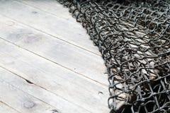 Redes de pesca sobre o fundo de madeira com espaço da cópia Imagem de Stock