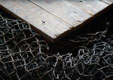 Redes de pesca sobre o fundo de madeira com espaço da cópia Imagens de Stock Royalty Free
