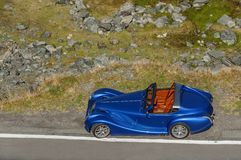 Redesigned blue cabriolet old car top view. Royalty Free Stock Image