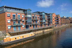 Redevelopment Alongside the Rive Aire, Leeds Yorkshire. A view of the River Aire, Leeds, Yorkshire, England. An old industrial area renovated with offices, flats Stock Photography