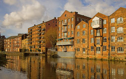 Redevelopment Alongside the Rive Aire, Leeds Yorkshire. A view of the redevelopment of the Victorian warehouses along the River Aire in Leeds into offices Stock Photo
