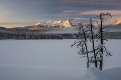 Redfish Lake in the mountains of Idaho covered with snow and fog royalty free stock photography