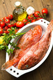 Redfish with tomatoes, parsley, garlic and olve oil Royalty Free Stock Image