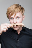 Redhair boy with wood comb. Stock Images