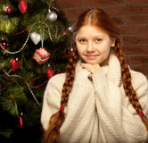 Redhair christmas woman wit apple. Royalty Free Stock Photography