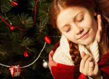 Redhair christmas woman wit apple. Stock Photo