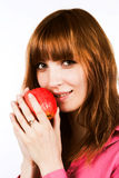 Redhair girl with apple Royalty Free Stock Photos