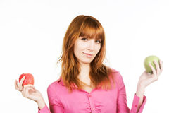 Redhair girl with apple over white background Royalty Free Stock Image