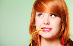 Redhair girl holding sweet food jelly candy on green. Stock Photography