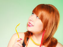 Redhair girl holding sweet food jelly candy on green. Royalty Free Stock Photo
