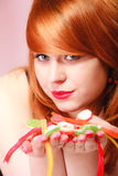 Redhair girl holding sweet food jelly candy on pink. Royalty Free Stock Photos