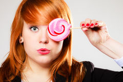 Redhair girl with pink lollipop royalty free stock image