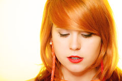 Redhair girl portrait wearing sweet jelly candy earrings Stock Photography