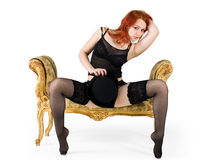 Redhair girl on a sofa Stock Images