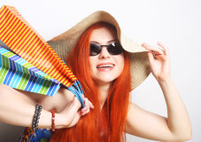 redhair shopping woman wearing sunglasses and hat Stock Photo