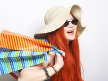 redhair shopping woman wearing sunglasses and hat Stock Image