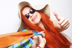 redhair shopping woman wearing sunglasses and hat Royalty Free Stock Photos