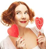 Redhair woman with big heart caramel Stock Images