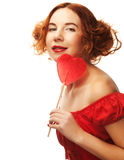 Redhair woman with big heart caramel Stock Image