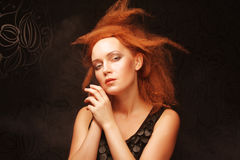 Redhair woman with creative hairstyle Stock Photo