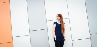 Redhair woman with freckles outside office break Stock Photography