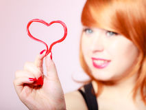 Redhair woman girl holding valentine red heart love. Valentines day. Stock Images