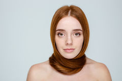 Redhair woman with hair over neck Stock Photography