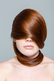 Redhair woman with hairs on eyes Stock Image