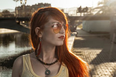 Redhair woman looking away backlit vintage headshot Stock Image