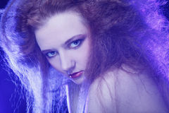 Redhair woman in smoke Royalty Free Stock Photos
