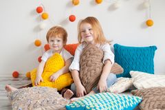 Redhaired children among pillows Royalty Free Stock Image