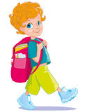 The redhaired curly-haired schoolboy fun walks goes to school. The redhaired curly-haired little boy schoolboy student fun walks goes to school to learn to read Stock Images