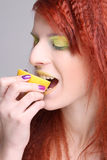 Redhaired girl eating the lemon Royalty Free Stock Photos
