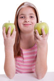 Redhaired  girl with green apple Royalty Free Stock Photography