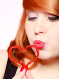 Redhaired girl holding red heart love blowing kiss. Valentines day. Stock Photography