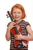 Redhaired girl loves music Stock Photo
