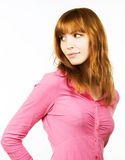 Redhaired girl in pink dress Stock Photography